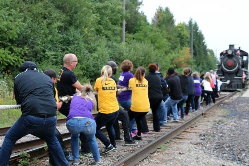 volunteers pulling train
