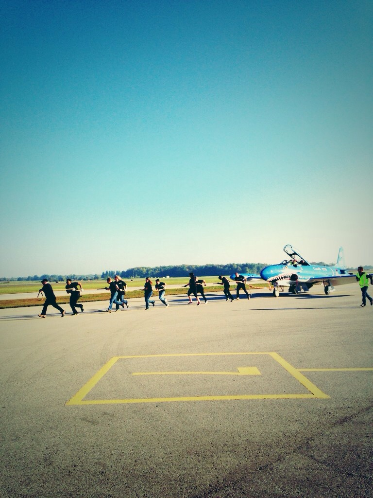 UW United Way Reps pull plane for 2014 Launch