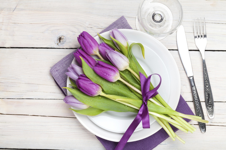 Purple tulips across dinner plate
