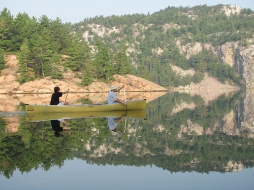 Tyler and his brother canoeing in Killarney Provincial Park