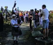 City of Waterloo surveyor (and piper), Finley MacLennan, leads the way at the opening of the GeoTime Trail.