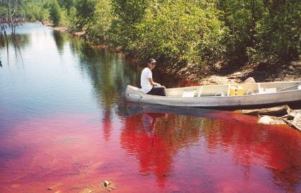 Person in a canoe at an acid mine lake