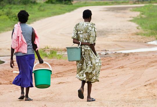 women walking with water