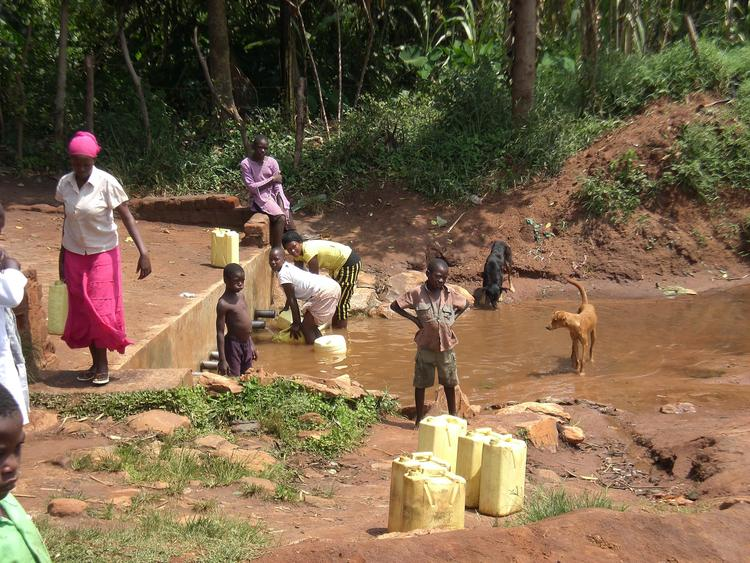women and children collecting water in Africa