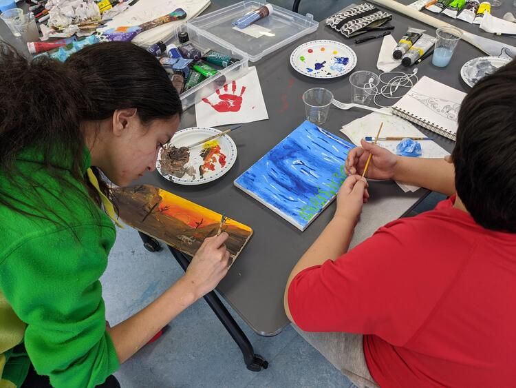 Indigenous youth creating pieces during the art camp on February 15, 2020