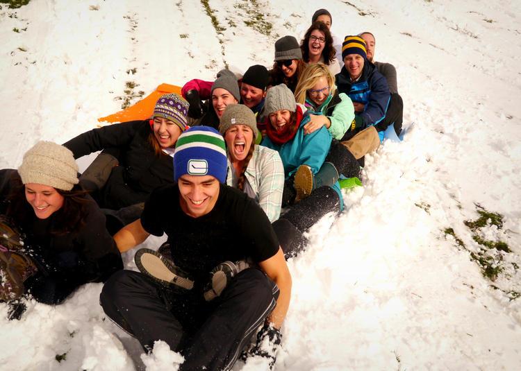 students sledding in Collaborative Water Program