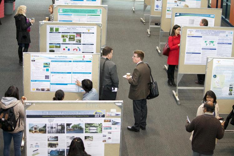 students presenting research posters at Symposium