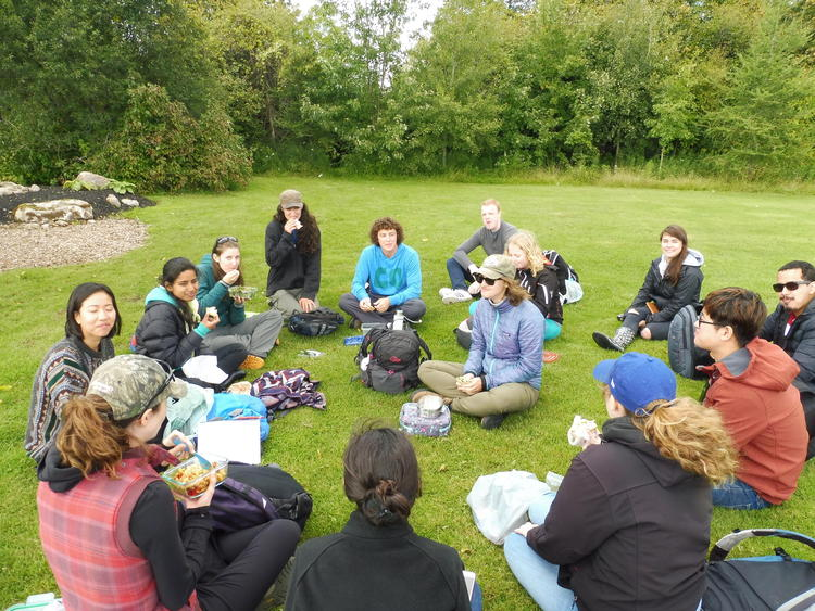 students learning in circle at the Grand River Watershed