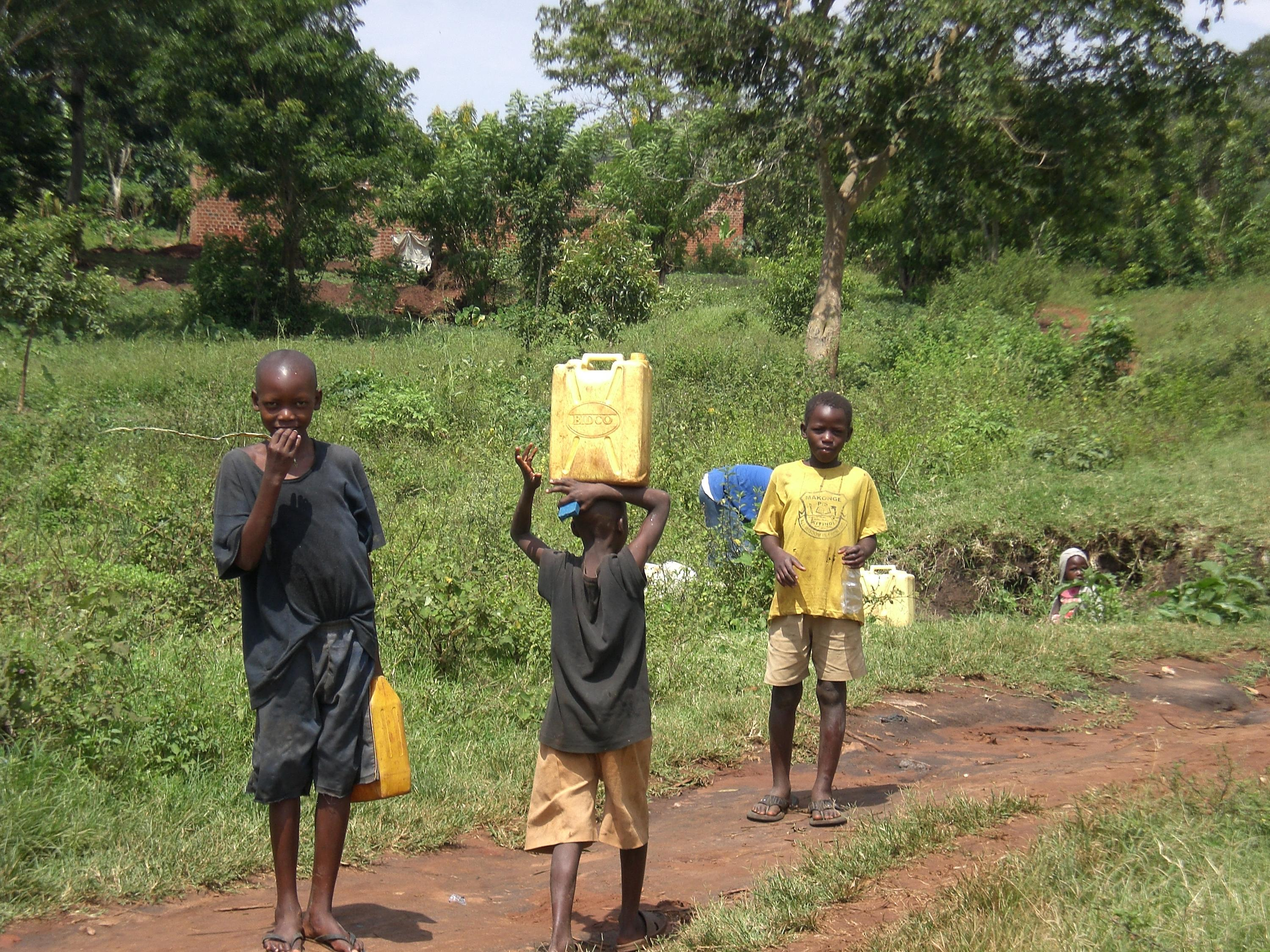 African children carrying water in Africa