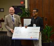 Arun Raj receiving giant check.