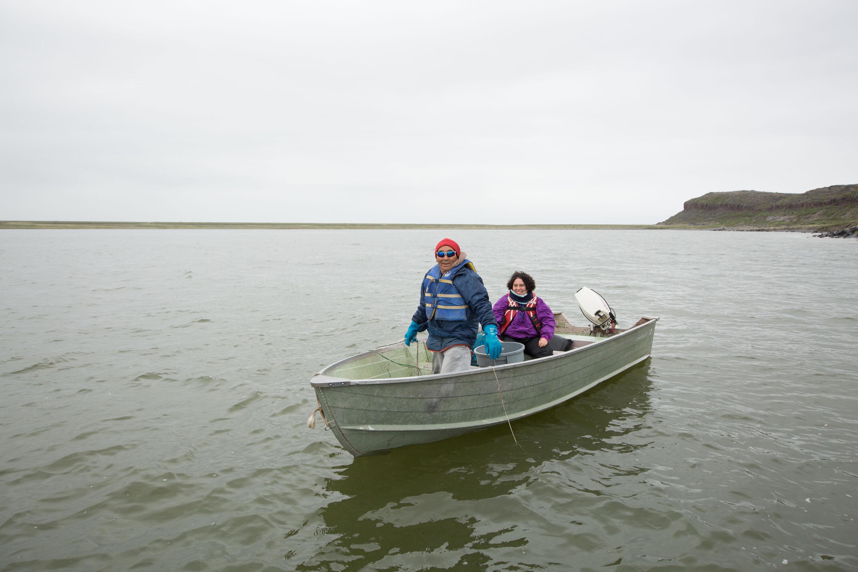 Spencer Weinstein and Kugluktuk, Nunavut community member in fishing boat
