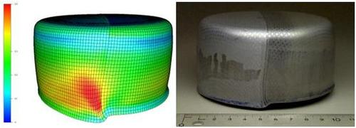 FE model (showing major strain contours) and experimentally drawn cup