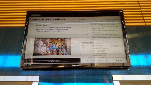 A TV used as a digital signage showing the Chemical Engineering department news, events, time, date, temperature, and banner.