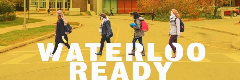 four students walking across campus