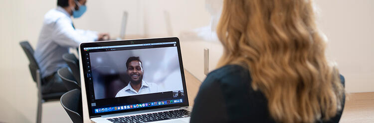 students talking via video call on a computer