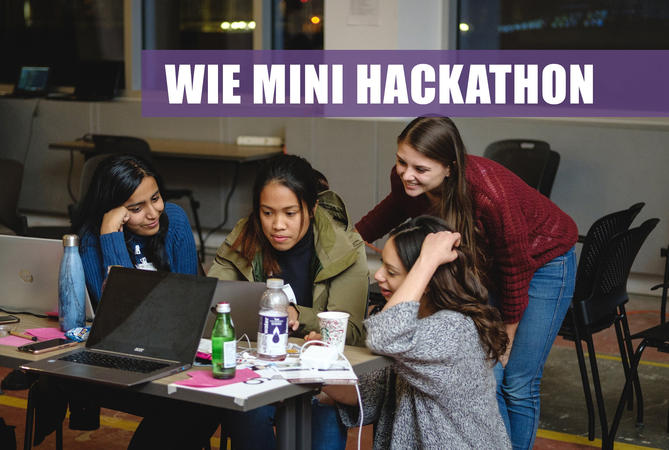 young girls working around a computer