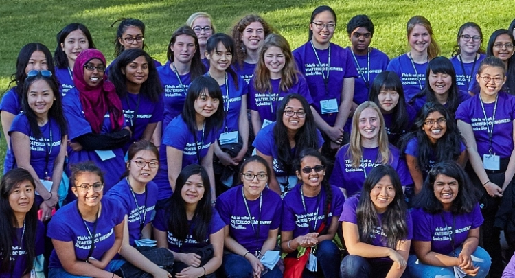 Group of women in purple t-shirts