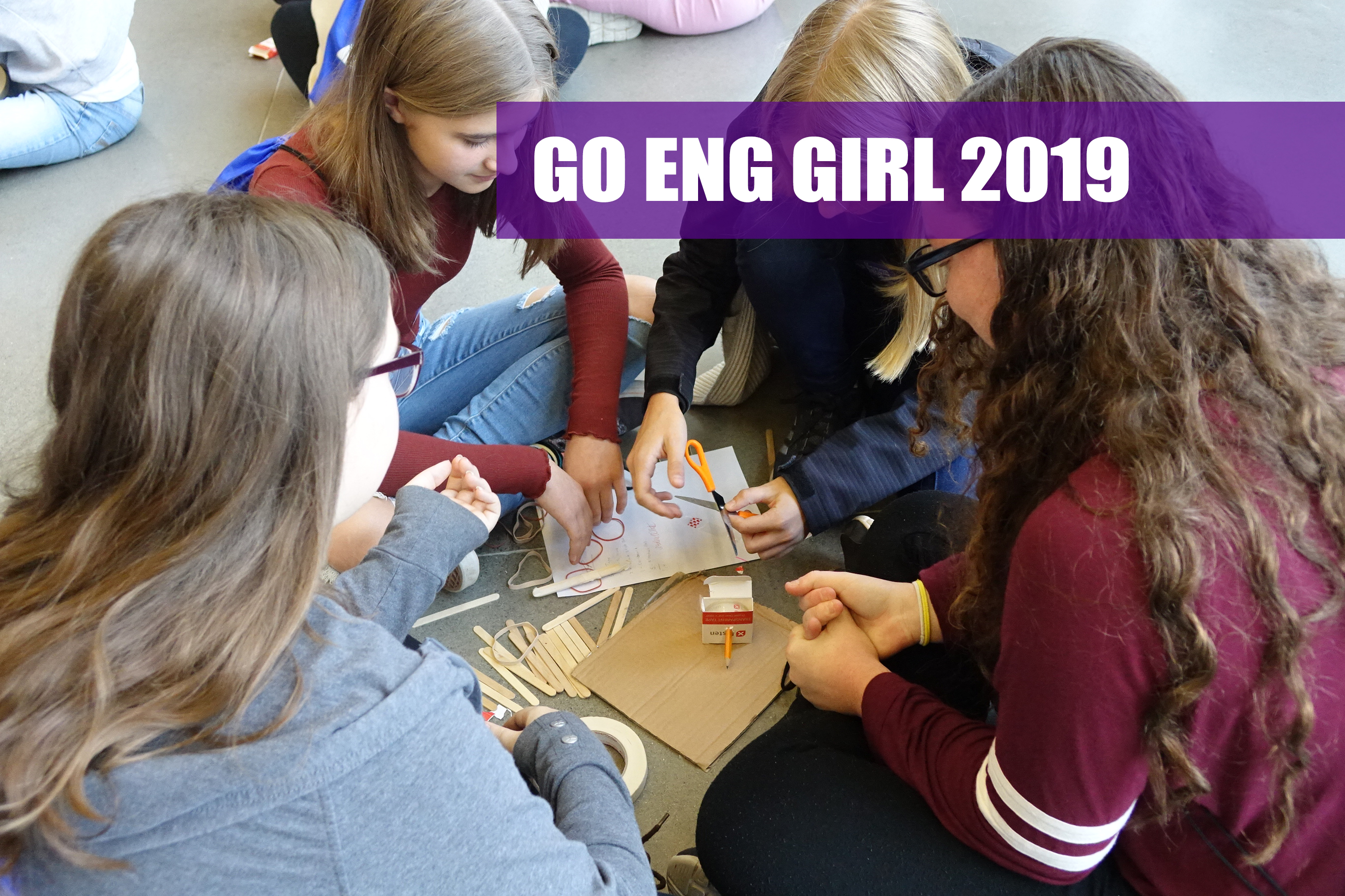 Group of girls working on a design challenge