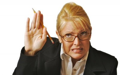 An image of a woman nervously riasing her hand