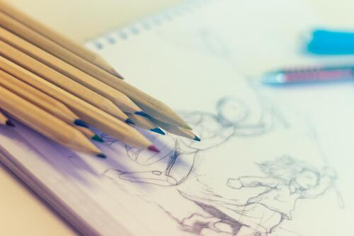 Close up image of pencils and artwork