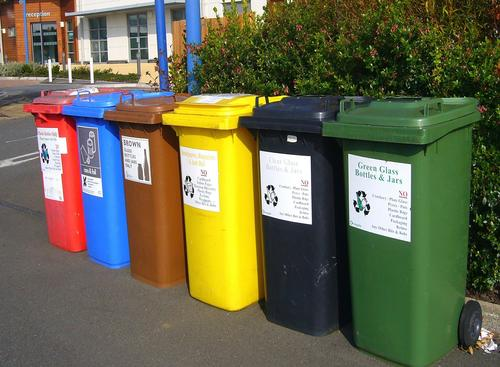 compost garbage and recycling bins outside