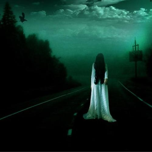 Unknown ghost girl standing in the middle of the road.