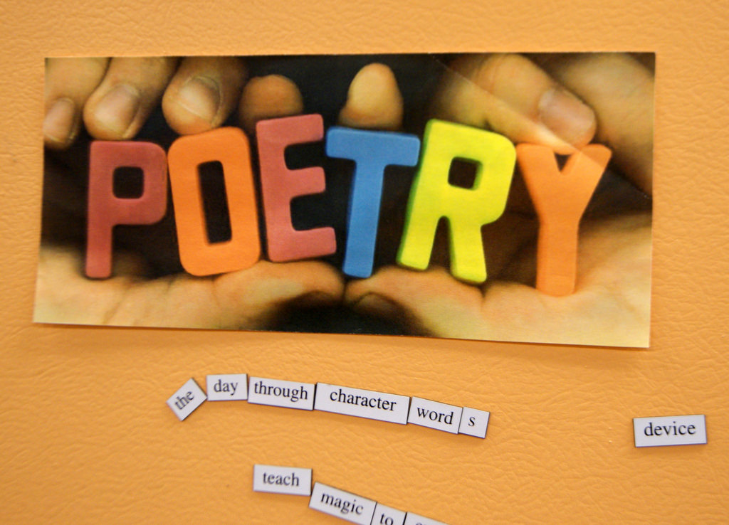 The word poetry is spelled out in colourful letters against an orange backdrop.