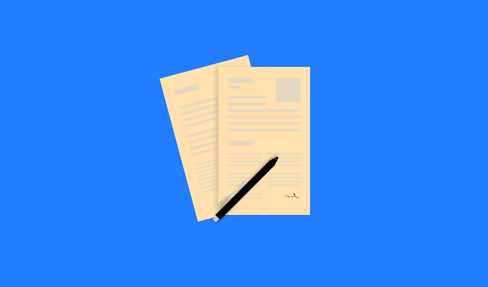 Photo (from Pixabay) of application papers against a blue backdrop