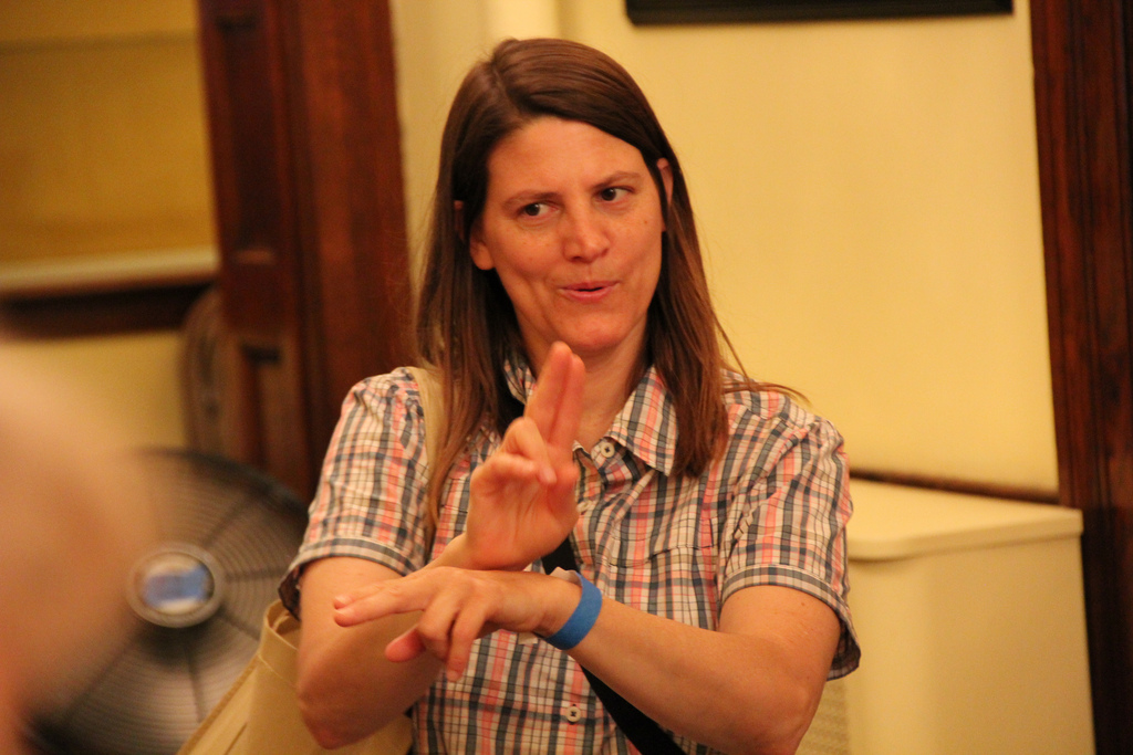a woman communicates in sign language