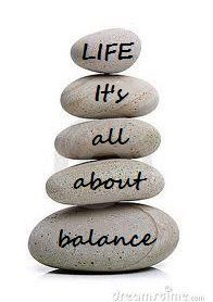"""it's all about balance"""" with one word on each rock"""