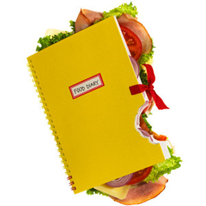 A yellow note book stuffed with food that has a bite taken out of it