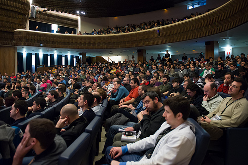 Image of a lecture hall full of people during RootedCON 2013