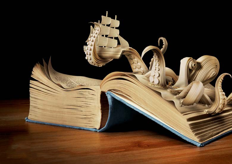 A picture of a paper octopus coming out of a book, clutching a paper ship